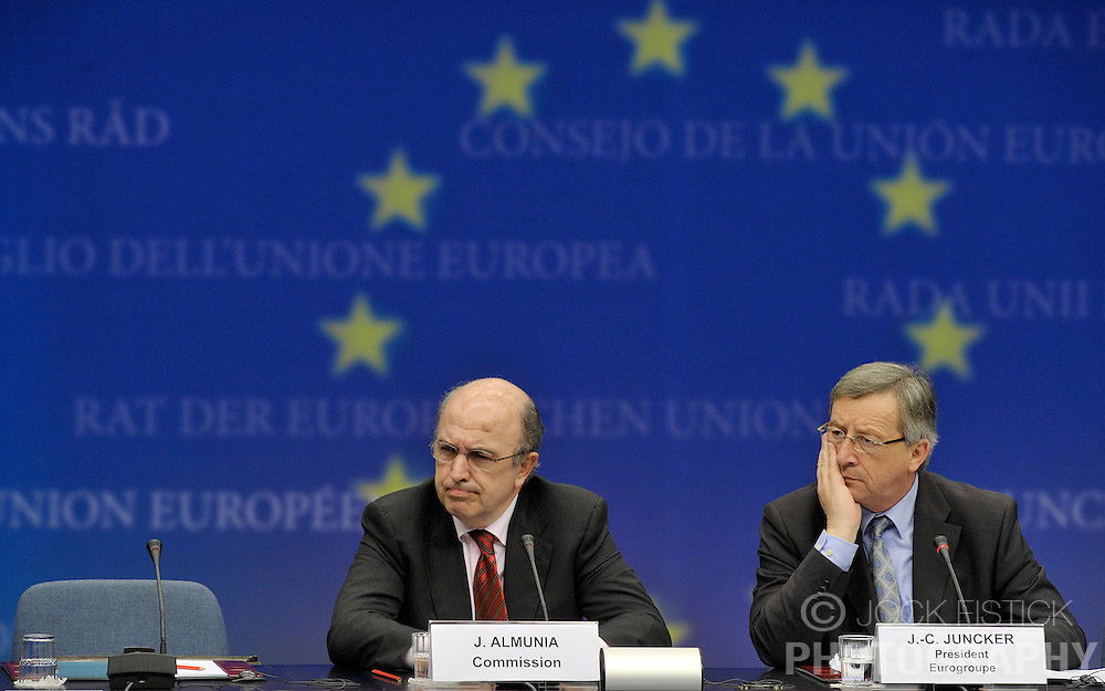 Joaquin Almunia, The EU's commissioner for economic and monetary affairs, left, and Jean-Claude Juncker, Luxembourg's prime minister and president of Euro Group, speak during a news conference, following the monthly Euro Group meeting in Brussels, Belgium, Monday, Feb. 9, 2009.  (Photo © Jock Fistick)