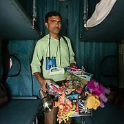 Peddler selling Kids toys, powerbank etc. <br /> Life on the longest train ride in India, between Kanyakumari and Dibrugarh city.
