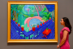"""© Licensed to London News Pictures. 06/02/2017. London, UK. A staff member views """"Red Pots in the Garden"""" at the preview of the world's most extensive retrospective of the work of David Hockney at the Tate Britain, which will be on display 9 February to 29 May 2017. Photo credit : Stephen Chung/LNP"""