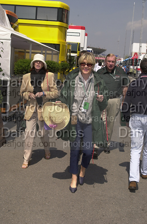 Jackie Stewart and Rosie Countes of Northampton. Grand Prix, Saturday, 28/4/01. Barcelona. 27 April 2001. © Copyright Photograph by Dafydd Jones 66 Stockwell Park Rd. London SW9 0DA Tel 020 7733 0108 www.dafjones.com