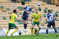 Jack Grimmer of Wycombe Wanderers heads the ball under pressure - Mandatory by-line: Arron Gent/JMP - 24/10/2020 - FOOTBALL - Carrow Road - Norwich, England - Norwich City v Wycombe Wanderers - Sky Bet Championship