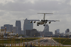 """London City Airport, May 5th 2015. With crosswinds gusting at up to 45 mph, several planes attempting to land at London City Airport have to abort their landings and do a """"go-round"""" whilst others endured rough landings.  PICTURED: With the wind crossing the runway from left to right, planes crab in sideways before straightening up on touchdown."""