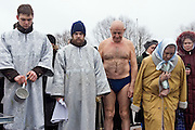 Moscow, Russia, 18/01/207.Russian priests and Orthodox believers celebrate Epiphany at Serebryany Bor in northern Moscow. Normally all rivers and lakes are frozen at this time of year, and the ceremony takes place on the frozen lake, with the believers being baptised in holes in the ice. However Moscow is experiencing its warmest winter ever, with the temperature plus 3 Celsius today, in contrast to minus 30 during last year's holiday.