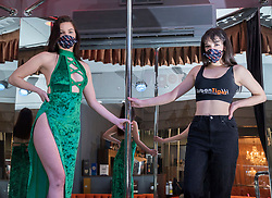 © Licensed to London News Pictures; 29/09/2021; Bristol, UK. FILE PICTURE dated 07/03/2021 of dancers AMELIE (left) and CHLOE (right) pictured at Urban Tiger. Bristol City Council has launched a consultation on whether to effectively ban Sexual Entertainment Venues (SEVs), otherwise known as strip clubs, by imposing a 'nil cap' policy which would lead to Bristol's two female owned strip clubs, Central Chambers and Urban Tiger, not having their licences renewed next year. At least 100 jobs with mainly female workers depend on the two clubs which offer stage shows, pole dancing and lap dances. There have been no breaches of the club's licences or evidence of a rise in crime near the clubs. Previous public consultations showed the majority of respondents were happy for SEVs to operate in Bristol. Bristol Mayor Marvin Rees, Bristol Labour MPs Thangam Debbonaire and Kerry McCarthy and some womens' groups in Bristol oppose the licence renewals, but some councillors and other groups in the city including burlesque performers and LGBTQ+ campaigners support the clubs to continue, amid debates over the dancers rights to work, equality, feminism, objectifying women and sex related violence. Campaigners for the clubs say that banning strip clubs discriminates against women performers and LGBTQ+ customers and will drive the industry underground with no regulation and threaten the safety of women performers. Photo credit: Simon Chapman/LNP.