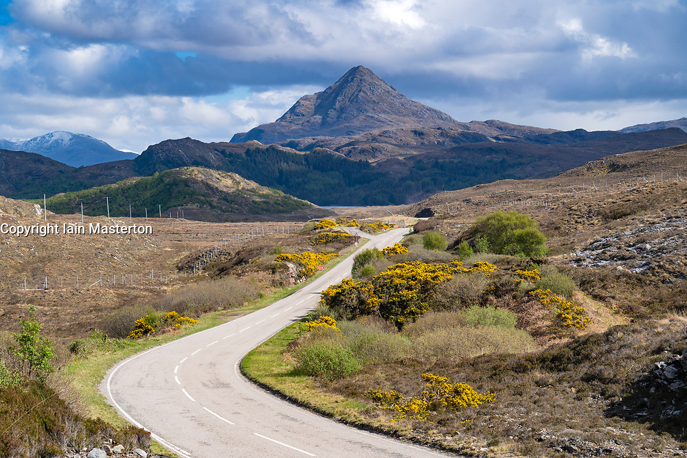 View of Ben Stack and highway on the North Coast 500 scenic driving route in Sutherland,  northern Scotland, UK