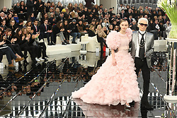 Vanessa Paradis watches her daughter Lily-Rose Depp and designer Karl Lagerfeld walking on the runway during the Chanel Haute Couture Spring Summer 2017 shows as part of Paris Fashion Week on January 24, 2017 in Paris, France. Photo by ABACAPRESS.COM  | 579504_013 Paris France