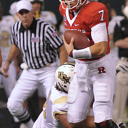 Dec 19, 2009; St. Petersburg, Fla., USA; Rutgers quarterback Tom Savage (7) escapes a tackle during NCAA Football action in Rutgers' 45-24 victory over Central Florida in the St. Petersburg Bowl at Tropicana Field.