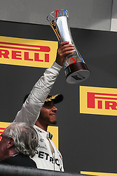 October 21, 2018 - Austin, TX, U.S. - AUSTIN, TX - OCTOBER 21: Mercedes driver Lewis Hamilton (44) of Great Britain holds third place trophy after the F1 United States Grand Prix on October 21, 2018, at Circuit of the Americas in Austin, TX. (Photo by John Crouch/Icon Sportswire) (Credit Image: © John Crouch/Icon SMI via ZUMA Press)