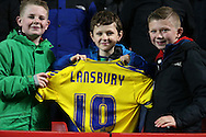 Young Nottingham Forest fans hold up the shirt of Henri Lansbury of Nottingham Forest after the player had given it to the young fans. Skybet football league championship match, Charlton Athletic v Nottingham Forest at The Valley  in London on Saturday 2nd January 2016.<br /> pic by John Patrick Fletcher, Andrew Orchard sports photography.