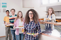 University students standing with lunch in canteen, Bavaria, Germany
