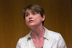 © Licensed to London News Pictures. 19/03/2015. London, UK. Shadow Home Secretary, Yvette Cooper answering questions at the Pink News LGBT election debate held at the Welcome Collection in central London. Photo credit : Vickie Flores/LNP