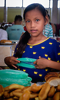 NAUTA, PERU - CIRCA OCTOBER 2015:  Girl selling bread in Nauta market in the Peruvian Amazon