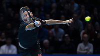 Tennis - 2019 Nitto ATP Finals at The O2 - Day One<br /> <br /> Singles Group Bjorn Borg: Roger Federer (Switzerland) vs. Dominic Thiem (Austria)<br /> <br /> Roger Federer (Switzerland) in action in the first set <br /> <br /> COLORSPORT/DANIEL BEARHAM