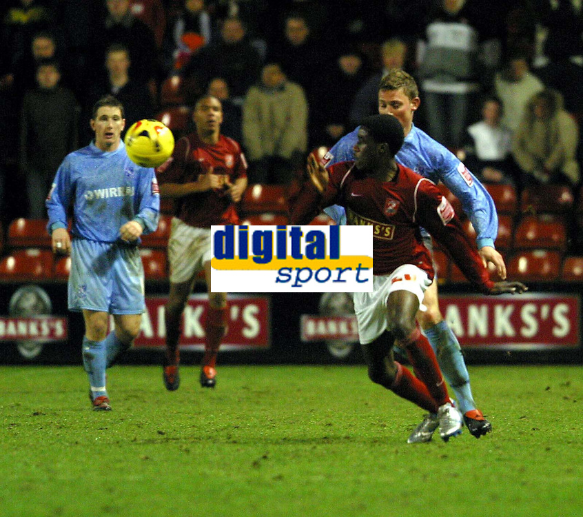 Photo: Dave Linney.<br />Walsall v Tranmere Rovers. Coca Cola League 1.<br />26/12/2005.Daryl Taylor(Walsall) on the attack with  Simon Francis(Tranmere)in close pursuit.