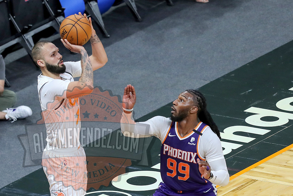 ORLANDO, FL - MARCH 24: Evan Fournier #10 of the Orlando Magic attempts a shot over Jae Crowder #99 of the Phoenix Suns during the second half at Amway Center on March 24, 2021 in Orlando, Florida. NOTE TO USER: User expressly acknowledges and agrees that, by downloading and or using this photograph, User is consenting to the terms and conditions of the Getty Images License Agreement. (Photo by Alex Menendez/Getty Images)*** Local Caption *** Evan Fournier; Jae Crowder
