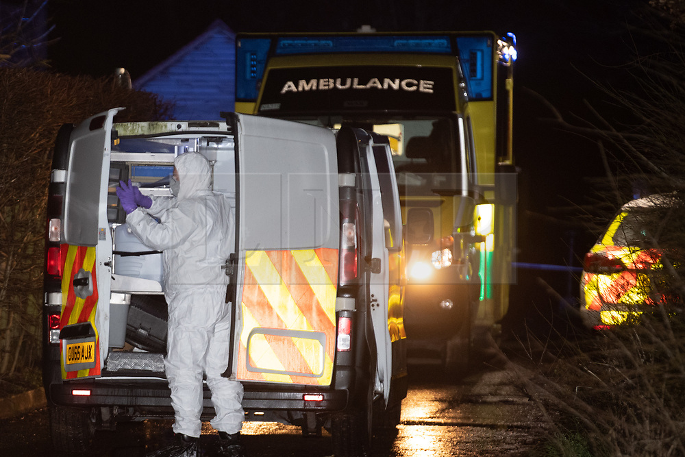"""© Licensed to London News Pictures.  03/01/2021. Reading, UK. Police forensics at the scene on Gravel Hill. Paramedics and police have responded to a """"serious incident"""" in Reading on Sunday evening, forensic investigators were seen gathering evidence from an ambulance outside a property on Gravel Hill, reports that a teenager had been stabbed are yet to be confirmed by police. Credit: Peter Manning/LNP"""