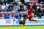 Ryan Colclough of Wigan Athletic looks to get away from Bruno Ecuele Manga of Cardiff City. EFL Skybet Championship match , Wigan Athletic v Cardiff city at the DW Stadium in Wigan, Lancs on Saturday 22nd April 2017.<br /> pic by Chris Stading, Andrew Orchard sports photography.