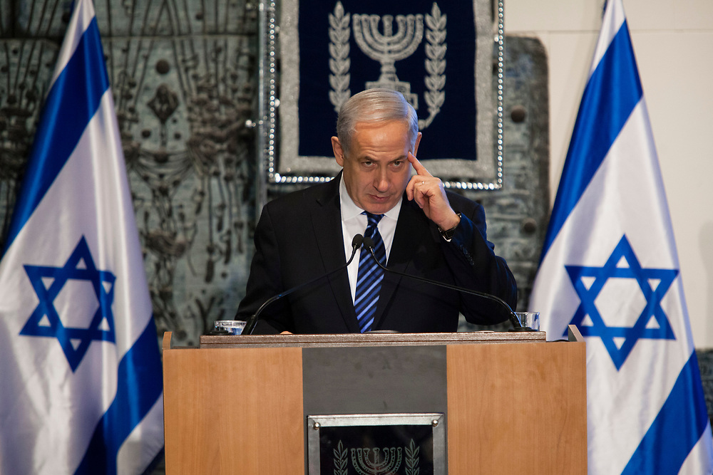 Israel's Prime Minister Benjamin Netanyahu gestures as he speaks during an annual memorial service for late Israeli Presidents and Prime Ministers at the President's Residence in Jerusalem, Israel, on May 12, 2013.