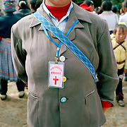 Miao woman at Qie Chong village's 100 years anniversary of the Catholic church celebration, Guizhou province, China.