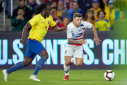 March 21, 2019 - Orlando, FL, U.S. - ORLANDO, FL - MARCH 21: United States forward Paul Arriola (7) battles with Ecuador defender Juan Carlos Paredes (4) in game action during an International friendly match between the United States and Ecuador on March 21, 2019 at Orlando City Stadium in Orlando, FL. (Photo by Robin Alam/Icon Sportswire) (Credit Image: © Robin Alam/Icon SMI via ZUMA Press)