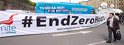 Theresa May <br /> Leader of the Conservatives <br /> launches The Conservative Party manifesto in Halifax, West Yorkshire, Great Britain <br /> 18th May 2017 <br /> <br /> General Election '17 <br /> Campaign event <br /> <br /> End zero hours Unite the Union banner unfurled infront of the Conservative battle Bus <br /> <br /> <br /> <br /> <br /> Photograph by Elliott Franks <br /> Image licensed to Elliott Franks Photography Services