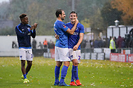 Brett Pitman of Portsmouth congratulates David Wheeler of Portsmouth after their 4-0 win over Maidenhead United during the The FA Cup 1st round match between Maidenhead United and Portsmouth at York Road, Maidenhead, United Kingdom on 10 November 2018.