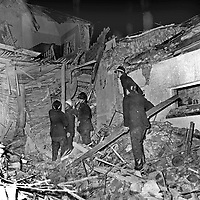 Firemen scramble through the wreckage of the home of Ulster Unionist Senator Jack Barnhill following an Official IRA bomb attack. Senator Barnhill was fatally show when he answered the doorbell of his home near the Tyrone-Donegal border with the Rep of Ireland. The Official IRA subsequently claimed that it had not been their intention to kill Barnhill but he grappled with the men who had come to plant the bomb. 197112120555. 555/71, linenhall.<br />