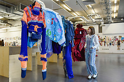 """© Licensed to London News Pictures. 11/05/2017. London, UK.  Colourful garments on display at an exhibition called """"Up and Coming"""", in Granary Square King's Cross, featuring works by Central Saint Martins foundation students.   Photo credit : Stephen Chung/LNP"""