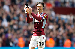 Aston Villa's Jack Grealish applauds the fans while holding the Sky Bet Man of the Match award after the final whistle