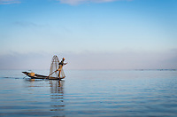 INLE LAKE, MYANMAR - CIRCA DECEMBER 2013: Fisherman rowing a typical boat in the Inle Lake, Myanmar