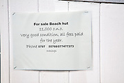 Advert sign for beach hut sale ( phone number disguised)