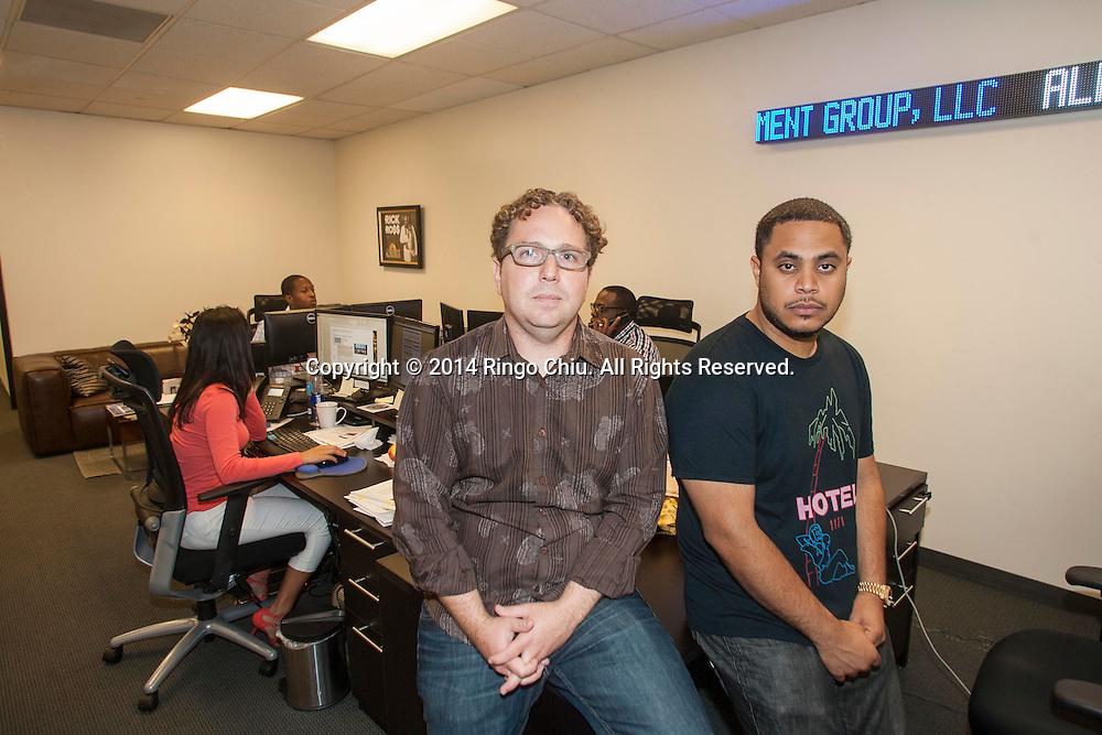 Anthony Saleh, right, and Adam Corey, Partners, QueensBridge Venture Partners.(Photo by Ringo Chiu/PHOTOFORMULA.com)