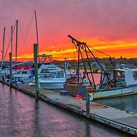 Cape Cod harbor scenery photography of fishing boats and sail boats at the Cape Cod Bay Wellfleet Marina and Harbor in Wellfleet, Massachusetts.