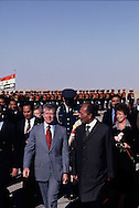 President Carter and Anwar Sadat at the airport in Aswan as President Jimmy Carter visits Egypt on January 4, 1978<br /> Photo by Dennis Brack