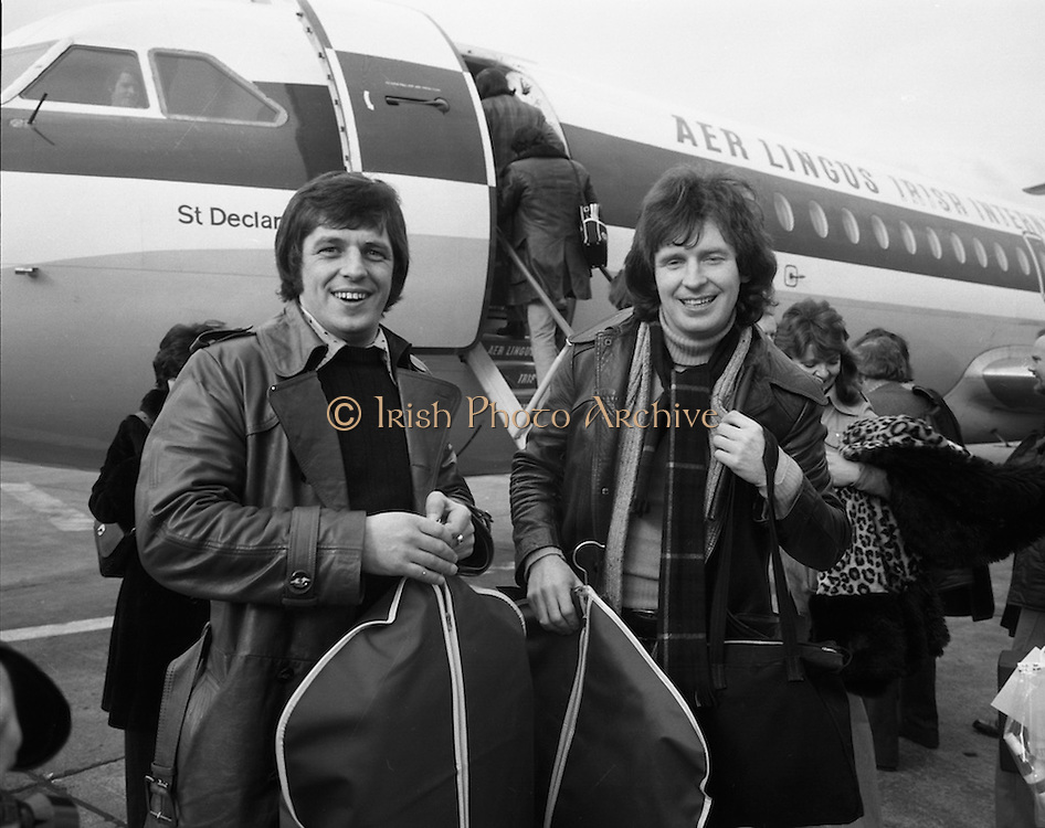 """The Swarbriggs Go To Eurovision Final.<br /> 1975.<br /> 18.03.1975.<br /> 03.18.1975.<br /> 18th March 1975.<br /> Following their success in the National Song Contest, the Swarbrigg brothers, Tommy and Jimmy had the honour of representing Ireland In The Eurovision Song Contest. The contest will be staged in Stockholm, Sweden. Sweden were last years' winners with """"Teach In"""" sung by """"Ding a Dong"""".<br /> <br /> Image of Jimmy (L) and Tommy Swarbrigg as they are about to board the Aer Lingus aircraft bound for Sweden."""