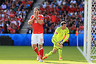 Sam Vokes of Wales reacts after he heads wide of goal. UEFA Euro 2016, last 16 , Wales v Northern Ireland at the Parc des Princes in Paris, France on Saturday 25th June 2016, pic by  Andrew Orchard, Andrew Orchard sports photography.