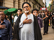23 OCTOBER 2015 - YANGON, MYANMAR:  A Shia Imam leads an Ashura procession in Yangon. Ashura commemorates the death of Hussein ibn Ali, the grandson of the Prophet Muhammed, in the 7th century. Hussein ibn Ali is considered by Shia Muslims to be the third imam and the rightful successor of Muhammed. He was killed at the Battle of Karbala in 610 CE on the 10th day of Muharram, the first month of the Islamic calendar. According to Myanmar government statistics, only about 4% of the population is Muslim. Many Muslims have fled Myanmar in recent years because of violence directed against Burmese Muslims by Buddhist nationalists.    PHOTO BY JACK KURTZ
