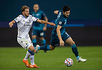 SAINT-PETERSBURG, RUSSIA - OCTOBER 20: Sardar Azmoun of Zenit St Petersburg tussles with Mats Rits of Club Brugge KV during the UEFA Champions League Group F match between Zenit St Petersburg and Club Brugge KV at Gazprom Arena on October 20, 2020 in Saint-Petersburg, Russia [Photo by MB Media]