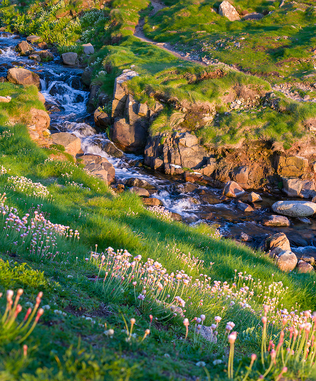 Stream flowing into the sea from St. Just along the Cornwall coastline.