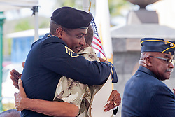 Keynote speaker SSG Rae Rouse gets a hug from his father Mr. Orville Rouse after his address.  St. Thomas Memorial Day Ceremony and Parade.  Franklin D. Roosevelt Veterans Park.  St. Thomas, USVI.  30 May 2016.  © Aisha-Zakiya Boyd