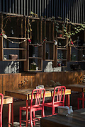 View of sidewalk cafe with lamps and traditional tables, Santiago, Chile