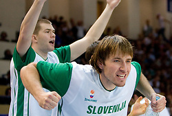 Uros Slokar (4) of Slovenia and Matjaz Smodis (8) of Slovenia during the basketball match at 1st Round of Eurobasket 2009 in Group C between Slovenia and Spain, on September 09, 2009 in Arena Torwar, Warsaw, Poland. Spain won 90:84 after overtime. (Photo by Vid Ponikvar / Sportida)