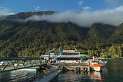 Tourists getting on cruise ship on lake, mountain with forest on background, Todos los Santos Lake, Chile