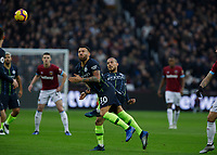 Football - 2018 / 2019 Premier League - West Ham United vs. Manchester City<br /> <br /> Nicolas Otamendi (Manchester City) winces after he is caught by David Silva (Manchester City) at the London Stadium<br /> <br /> COLORSPORT/DANIEL BEARHAM