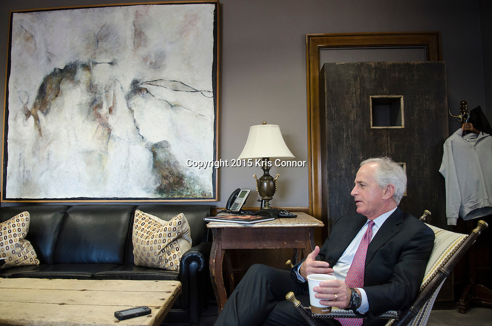 Senator Bob Corker(R-TN) speaks about the different pieces Tennessee art that line the walls of his Washington DC senate office in the Dirksen Senate Office Building in Washington DC on December 10, 2015. Photo by Kris Connor
