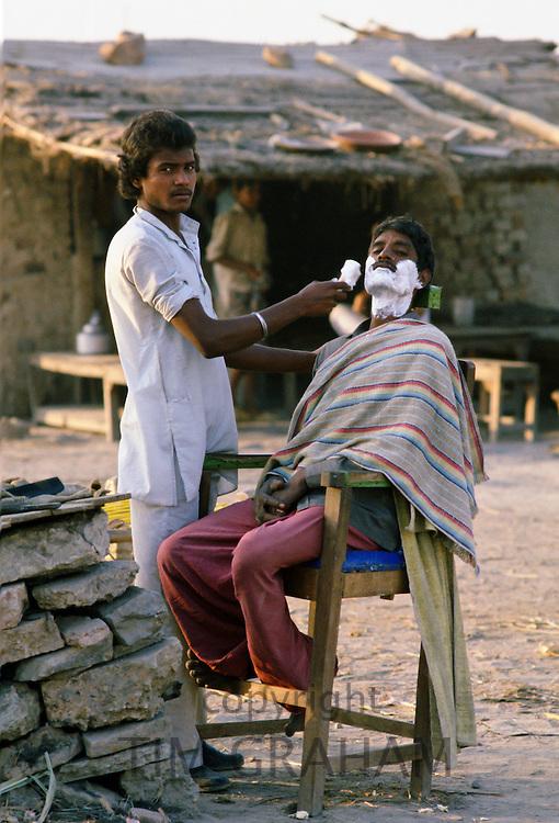 Street Barber, Delhi, India.