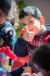 17 February 2020, Zarqa, Jordan: A boy smiles and gives a thumbs-up in 'the nanny room' at the Lutheran World Federation community centre in Zarqa. Through a variety of activities, the Lutheran World Federation community centre in Zarqa serves to offer psychosocial support and strengthen social cohesion between Syrian, Iraqi and other refugees in Jordan and their host communities.