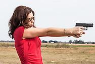Woman with a handgun