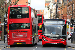 © Licensed to London News Pictures. 11/02/2020. London, UK. Buses on high road in north London as Prime Minister, BORIS JOHNSON announces £5 billion new funding to improve bus services and cycle lanes across the country, which will transform with simpler fares, thousands of new buses, improved routes and higher frequencies.<br /> There will be at least 4,000 new Zero Emission Buses to make greener travel, driving forward the UK's progress on its net zero ambitions. Photo credit: Dinendra Haria/LNP