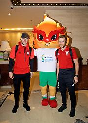 NANNING, CHINA - Tuesday, March 20, 2018: Wales' Gareth Bale and Adam Matthews pose for a photo with the official China Cup mascot at Nanning International Airport for the 2018 Gree China Cup International Football Championship. (Pic by David Rawcliffe/Propaganda)